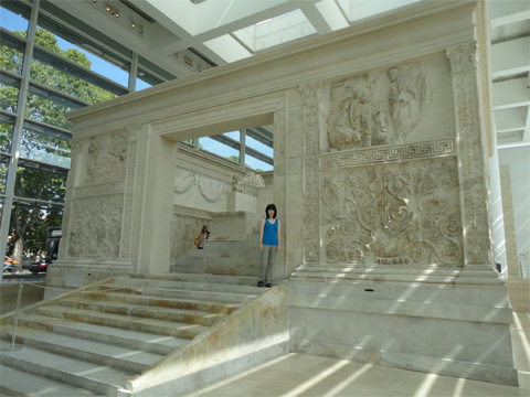 The author and the Ara Pacis, a famous example of mythic imagery paired with historical reality.