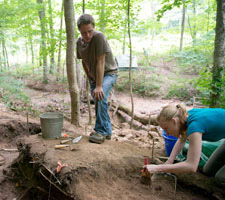 Student Tatiana Fox (right) participates in the Ohio University Archaeological Field School directed by Paul Patton (left), an adjunct anthropology faculty member in the College of Arts and Sciences.  Photographer: Ben Wirtz Siegel