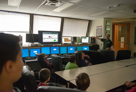 Fifth graders at Nelsonville-York Elementary School listen to Dr. Ryan Fogt discuss some of the technology used at the Scalia Laboratory for Atmospheric Analysis.