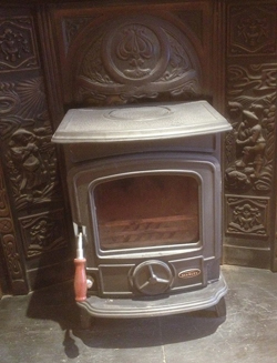 Steve Scanlan's Ireland apartment comes with a coal-burning stove, which he's not using.