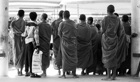 Young monks wait to join their peers. Monks receive offerings of food and money from devout Buddhists to receive their blessing and to help the spirits of their ancestors that died at the Killing Fields. Photos © Danielle Fultz 2014.