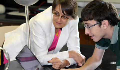 Frazier Baker, while a student at Ohio University Zanesville, shows his work to his mentor, Dr. Gabriela Popa, assistant professor of physics at the Zanesville campus.