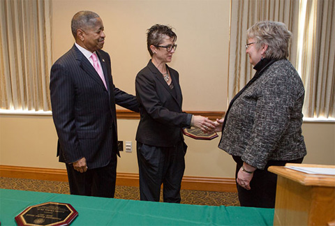 Ohio University President Roderick J. McDavis and Executive Vice President and Provost Pam Benoit (right) congratulate Dr. Katarzyna Marciniak. Photos by Lauren Pond/Ohio University