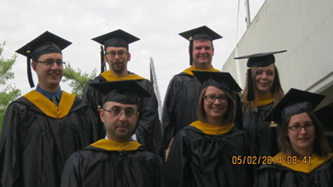 Master's candidates from Geological Sciences at graduate commencement 2014. Top: from left: Tim Eyerdom, Josh Richardson, Mike Hils, and Audrey Blakeman. Bottom from left: Mohanad Muslim, Katherine Schleich, and Jennifer Bauer.