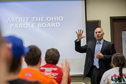 Marc Houk, a member of the Ohio Department of Rehabilitation and Correction Parole Board, speaks to a sociology class about a career in criminal justice.  Photographer: Katelyn Vancouver/Ohio University