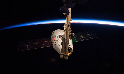 Expedition 42 commander and NASA astronaut Barry Wilmore and European Space Agency astronaut Samantha Cristoforetti used the Canadarm2 robotic arm to grapple the SpaceX Dragon (CRS-5) ship on Jan. 12 2015, two days after its launch from the Cape Canaveral Air Force Station, Florida. Dragon was attached to the station's Harmony module three hours after it was grappled, where it spent a month being unloaded. Image Credit: NASA