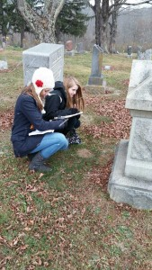 Hannah Vaughn and Kristen Ruble visit a Southeast Ohio cemetery to collect data for an Appalachia Population History Project.