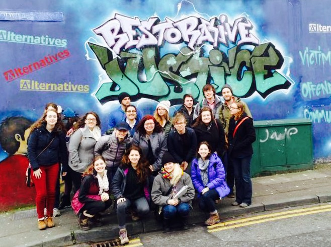 Students pose outside of Alternatives, a community-based restorative justice organization on Shankill Road in Belfast in 2015.