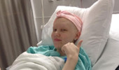 Katharine Welch gives a thumbs up during her chemotherapy treatments. Photo courtesy of: Katharine Welch