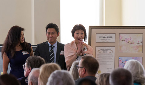 """(From left) Tamao Tanaka, Tim Tanaka and Norico Tanaka-Wada are presented a plaque in honor of their parents, Sumiko and Tomoyasu Tanaka. Their plaque – one of which was presented to the family and another that will be displayed in Tanaka Hall – included a watercolor painting of cherry blossoms that was created by Ohio University Executive Vice President and Provost Pam Benoit. Norico Tanaka-Wada noted that the family requested that their plaque highlight their parents' contribution to the OHIO-Chubu University relationship as reflected through the cherry blossom. """"The wonderful thing about the cherry blossoms is that their beauty is fleeting,"""" said Norico Tanaka-Wada. """"So only one week of the whole year is their beauty able to be appreciated, but now we have these beautiful pictures of the cherry blossoms that students can enjoy all year long."""" Photo by Jasmine Beaubien"""
