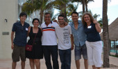 Sergio Ulloa poses with Nancy Sandler and recent graduate students in Cancun.