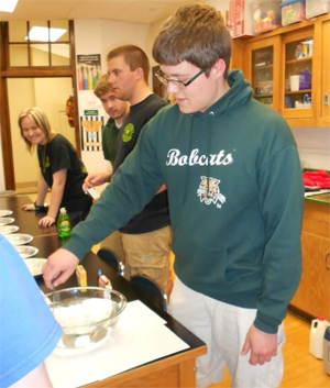 Members from OUCAMS volunteered time out of their day to attend the Athens Middle School's after-school science program in April 2014. They taught students about the polar vortex, temperature density, the water cycle, updrafts and even pressure.