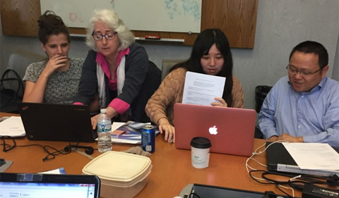 Dr. Coen (on right, second from the left) works with students on computer coding for agent-based model.