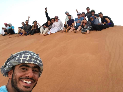 Jamie Moriarity takes a selfie with classmates in Oman.