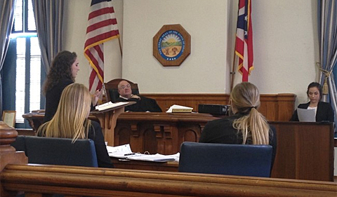 Ohio University Team Green Prosecution cross-examining a witness for Ohio University Team White Defense at Athens County Courthouse. Athens County Common Pleas Judge George McCarthy presided.