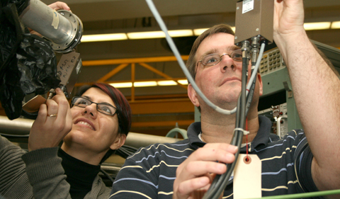 Michigan State University physicists Artemisia Spyrou and Sean Liddick work on the electronics for the silicon detector.