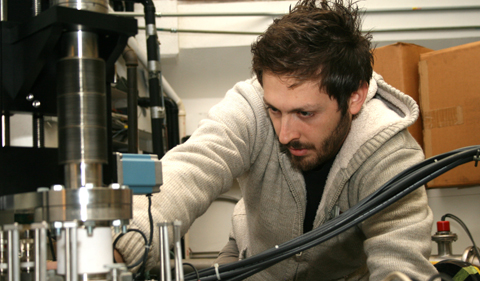 Panagiotis Gastis (Central Michigan University) checks the target position in the experiment chamber in the Edwards Accelerator Lab.