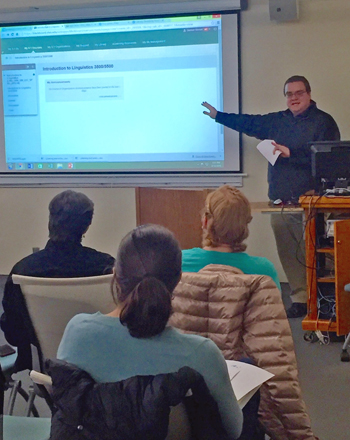 """Samuel Stinson, a Ph.D. student and Graduate Teaching Associate in English, discusses strategies for using Blackboard in his presentation, """"Classroom Technologies: Getting the Most out of Blackboard."""