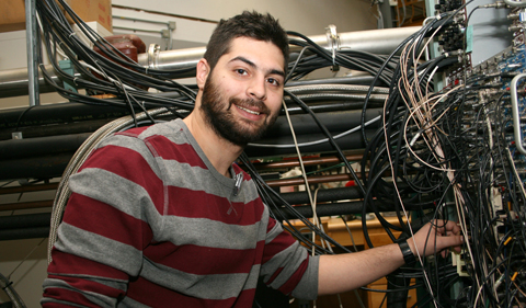 Stelios Nikas (Central Michigan University) at the electronics panel where signals are processed.