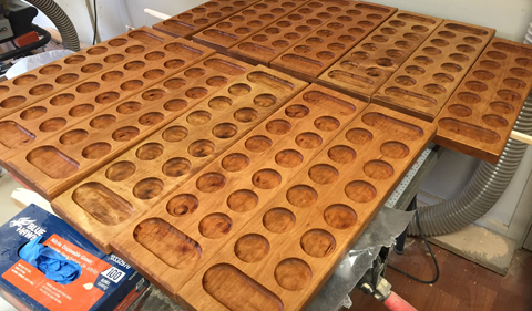 Getting ready for the Mancala Tournament--games laid out oin table