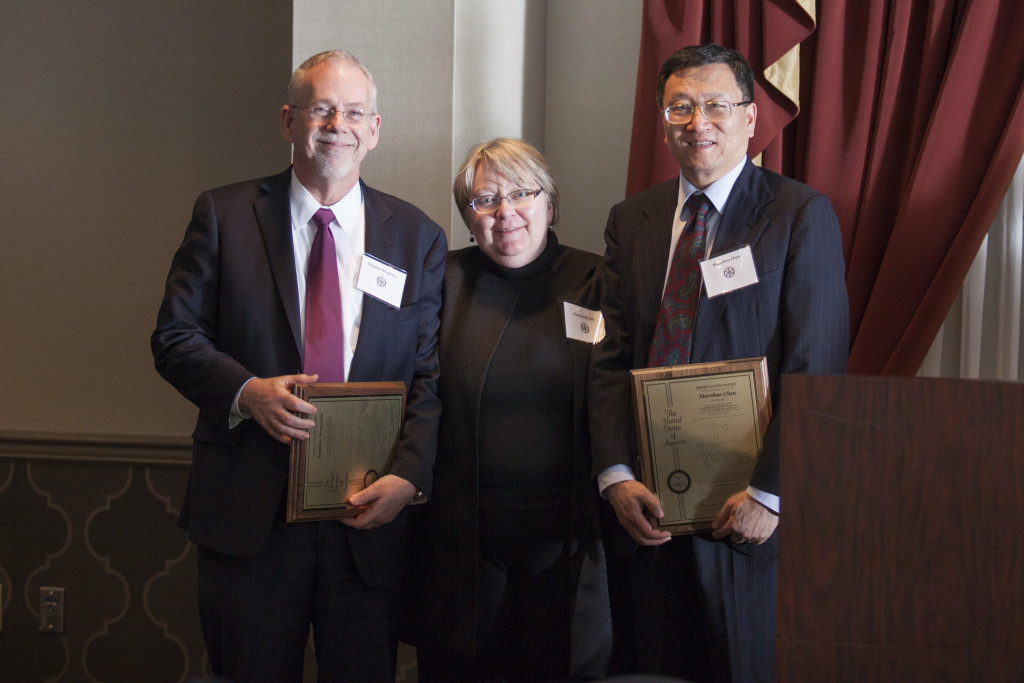 Executive Vice President and Provost Pamela Benoit, center, with inventors Stephen Bergmeier, left, and Xiaozhuo Chen, right. Photo: Kaitlin Owens.