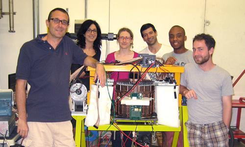 L to R: Dr. Marco Battaglieri, Dr. Raffaella DeVita, Dr. Erica Franchini (Post Doc), Giacomo Ottonello (technician), Ian Davenport (undergraduate, James Madison University), Max Camp - group with the Forward Tagger calorimeter