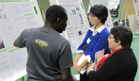 Plant Biology graduate student Damilola Eyitayo presents to the judges at the 2016 Expo.