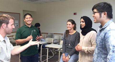 Joe Brehm, Rural Action Environmental Education Program Director, talks with students Kento Matsuoka, Illona Hartman, Khulood Al Harthi, and Yifu Zhang after group presentations