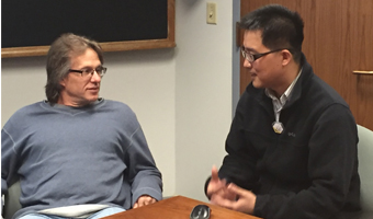 From left, Dr. Carl Brune discusses the experimental plan with Dr.Tony Ahn.