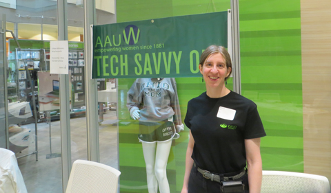 Dr. Melanie Schiori in front of the Tech Savvy sign