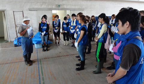 OHIO-IPU Tsunami Project team members in 2012 inside an elementary school in Otsuchi, Iwate destroyed by the 3.11 tsunami as a local resident recounts the destruction.