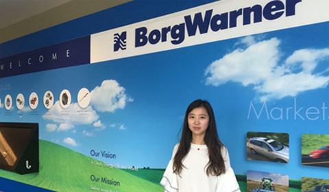 Chuyang Wu in front of BorgWarner sign