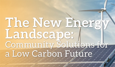Community Scale Solutions for a Low Carbon Future photo with windmill and solar panels