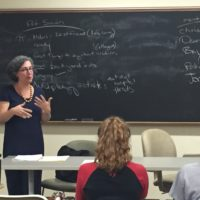 Dr. Mariana Dantas at front of classroom