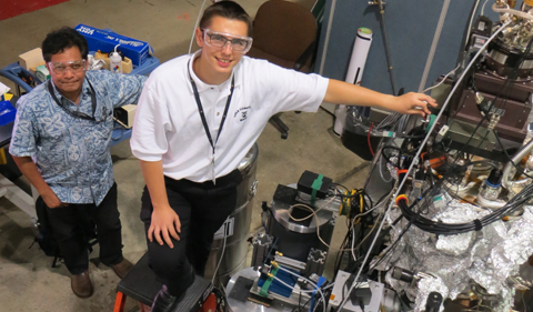 While Dr. Hla observes, I'm on the ladder with my fingers on the xyz manipulator stage that houses LT-UHV-SXSTM.Photo: Argonne National Lab