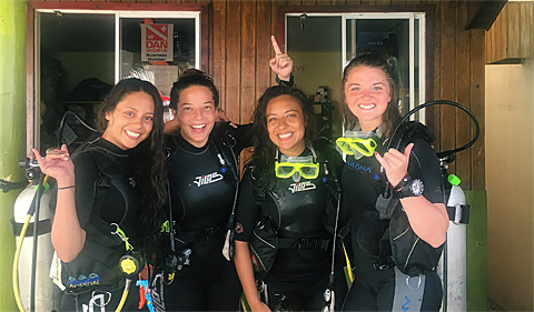 Holly Richardson (far right) and other GIVE volunteers built coral reefs, removed litter, and read to children while in Nicaragua.