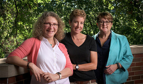 Faculty advisers to the Margaret Boyd Scholars Program (from left) Nancy Sandler, Michelle O'Malley and Cindy Anderson are pictured outside of Bryan Hall, the residence hall that houses the scholars during their sophomore year. Photo by Daniel Owen