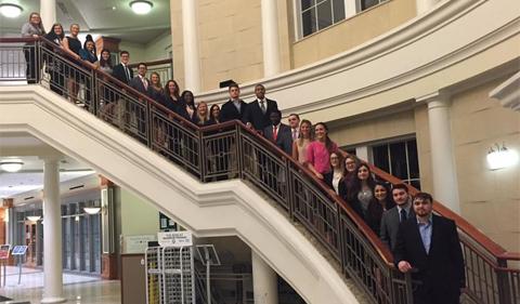Phi Alpha Delta co-ed fraternity members on staircase in Baker Center