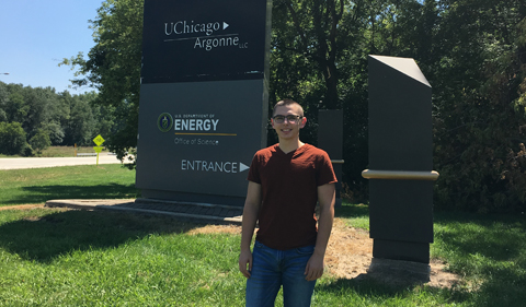 Ryan Tumbleson at the entrance to Argonne National Lab