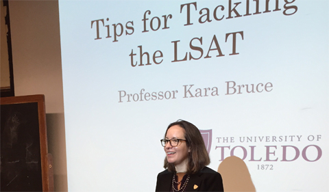 "Professor Bruce delivers ""Tips for Tackling the LSAT"" lecture. She is from the Univeristy of Toledo."