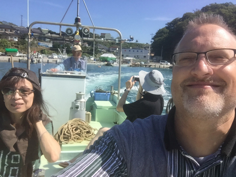 A selfie taken by Dr. Christopher Thompson, right, on a fishing boat off the coast of Nagasaki village, Iwate Prefecture. Thompson, Dr. Keiko Chiba, left, and Dr. Shiyong Wu (black shirt) were taken to scallop and seaweed beds offshore in the area by a local fisherman (driving the boat) on Sept. 25.