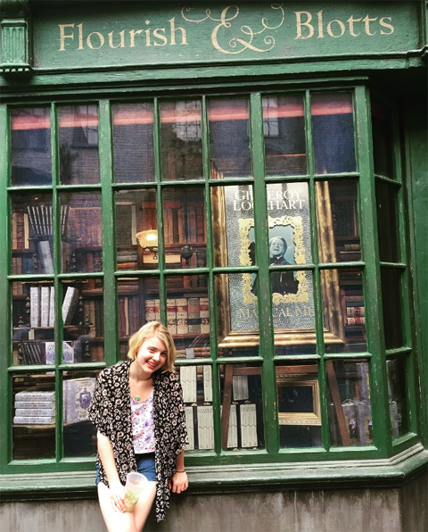 Hannah Koerner spent her summer as an intern at Melville House.publishers. She is pictured in the window of a bookstore called Flourish & Blotts.