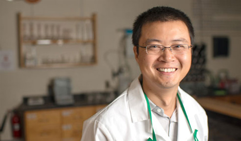 Dr. Jixin Chen in white lab coat