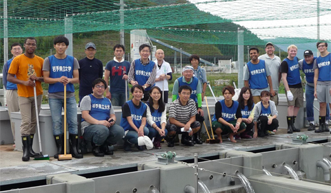 At the fish hatchery in Rikuzentakata, Iwate on Sept. 24: Far left wearing white shirt is OHIO Alum Greg King. OHIO's Ben Piper, Dr. Christopher Thompson, and Nick Farris are standing next to him left to right. OHIO's Dr. Shiyong Wu is standing in the background on the far left side.