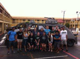 Students in front of van