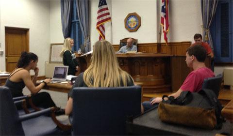 Team Green attorney McKenzie Allen directing her witness, Adam Gilles, as their coach, Grant Garber, presides.