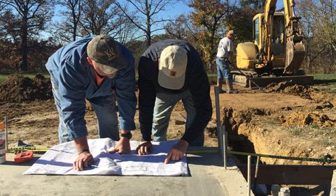 Contractors consulting blueprints