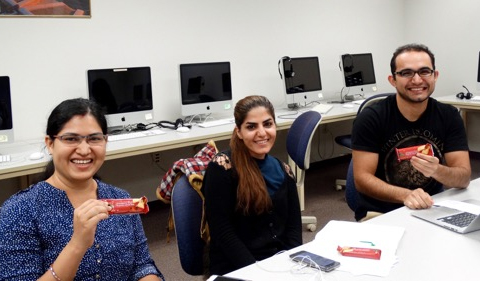 Students enjoy one of Hurley's weekly sweet treats. Pictured from left to right: Abanita Biswal, Maasoomeh Jafari, and Mehdi Rezaie.