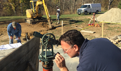 Mike Myers uses theodolite