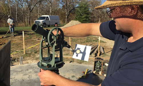 Mike Myers uses a theodolite at the Ohio University Observatory construction site.